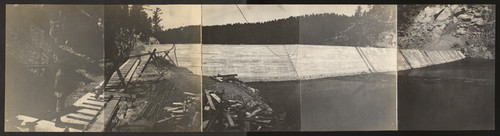 Strawberry Dam. Sept. 15, 1916. Panoramic view showing permanent spillway, spillway lip, and left abutment of dam, also complete apron showing steel extended for parapet and reinforced apron with cement gun facing