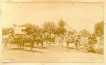 Carriages and People on Horseback