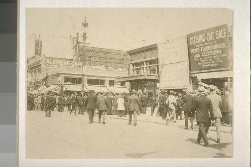 [Crowd gathered around bomb explosion site. Corner of Steuart and Market Streets, San Francisco. During Preparedness Day Parade, July 22, 1916.]