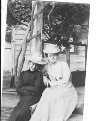 Emily Moll and Annie Morgan sitting on the steps of a house, about 1900