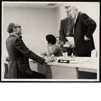 C.L. Dellums speaking with Lloyd Zempel at a meeting of the California Fair Employment Practices Commission meeting
