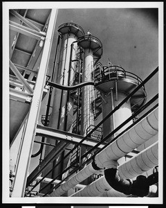 Exterior view of the Shell Oil Company, showing three cylindrical towers, ca.1940