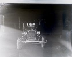 Vintage 1920s car in a repair garage, about 1930 or 1931
