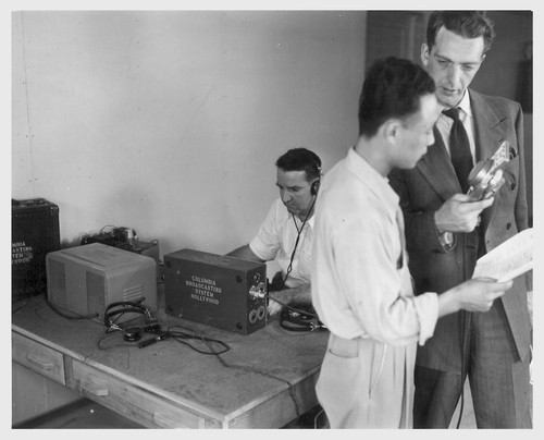 Poston, Ariz.--Kay Nishimura, evacuee of Japanese ancestry, and Chet Huntley (right), CBS announcer, in an interview at this War Relocation Authority center during a nationwide hookup.--Photographer: Clark, Fred--Poston, Arizona. 5/26/42