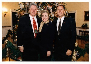Bill Clinton, Hilary Clinton, and Scott Hitt in front of Christm