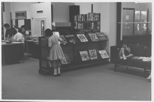 Patrons using the Dagny Juell Boys and Girls Room of the Library