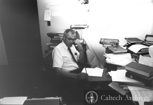Clair Patterson at his desk