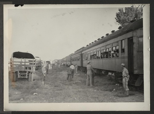 The train of Tule Lake evacuees as it arrived in Granada. Photographer: McClelland, Joe Amache, Colorado