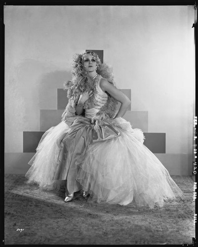 Peggy Hamilton modeling an Adrian tulle evening gown, 1929