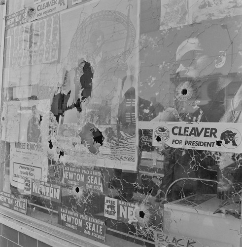 Plate glass window of the Black Panther Party National Headquarters, the morning it was shattered by the bullets of two Oakland policemen, #80 from A Photographic Essay on The Black Panthers