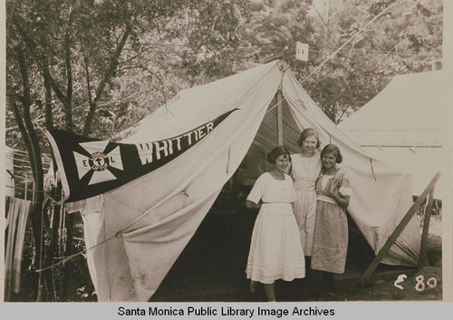 "Young women stand in front of a tent ""Whittier""at the Institute Camp, Temescal Canyon, Calif"