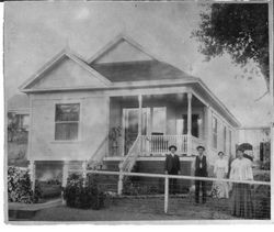 Emanuel Borba and others in front of his one story Queen Anne Cottage at 234 Pitt Avenue, built circa 1905