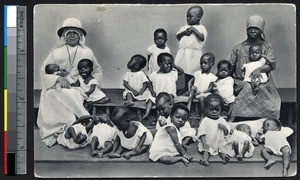 Missionary sister sitting with orphans, Yaounde, Cameroon, ca.1920-1940