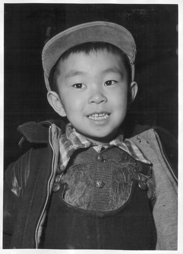A Sansei, or third generation boy of Japanese ancestry. His father, a Nisei, second generation, American citizen, and the rest of his family, evacuated from the west coast areas, now reside at the Heart Mountain Relocation Center. Photographer: Parker, Tom Heart Mountain, Wyoming