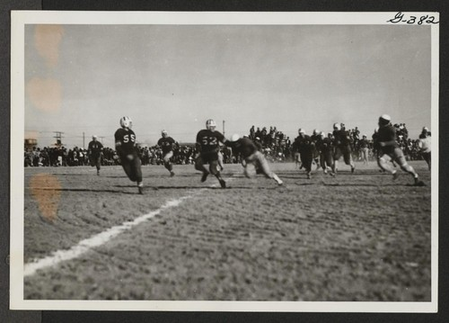 Over the line for a touchdown for Topaz in football game between Topaz and Fillmore high schools at Topaz Relocation Center on November 11, 1943. The score favored Topaz. Topaz, Utah