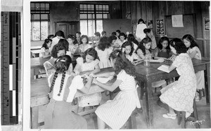 Maryknoll Sisters Anne Vincent and Concepcion teaching a science class at Catholic school in Lucena, Philippines, 1947