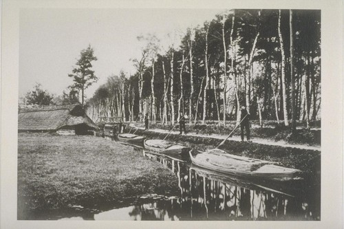 [Men with boats. Unidentified canal.]