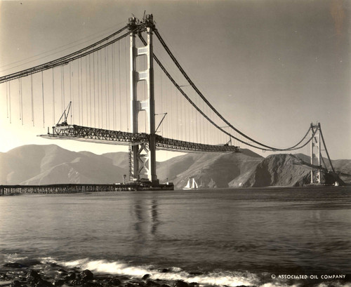 Looking towards Marin County from Fort Point in San Francisco, as the floor of the Golden Gate Bridge takes shape, October, 1936 [photograph]