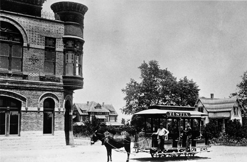 Horse car at intersection of Main and D Streets in front of Tustin First National Bank, ca. 1895