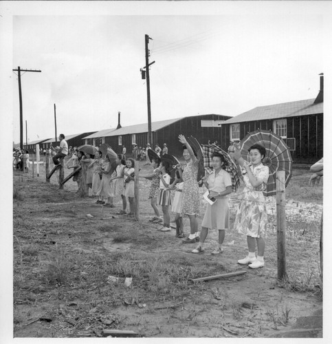 Closing of the Jerome Center, Denson, Arkansas. Evacuees still remaining in the Jerome Center wave to friends on the train
