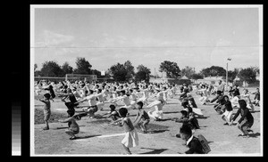 Students, faculty, and children doing exercises at Athletics Day, Yenching University, Beijing, China, 1938