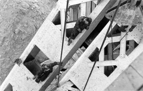 [Construction workers rivet sections of Golden Gate Bridge north tower]