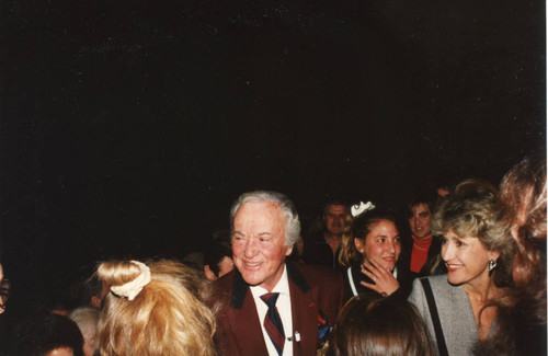 Photograph of Buddy Rogers greeting guests