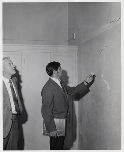 Julian Nava inspecting a school building
