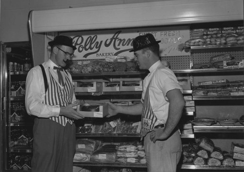 Two grocers in front of the Polly Ann Bakery display, Petaluma, California, about 1965