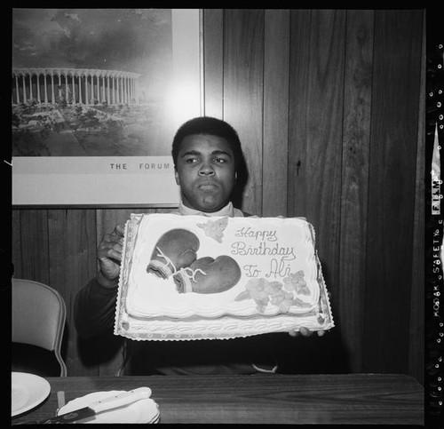 muhammad ali birthday Calisphere: Muhammad Ali holds up a birthday cake muhammad ali birthday