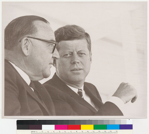 [Edmund G. Brown and John F. Kennedy talking at the San Luis Dam ground breaking ceremony.]