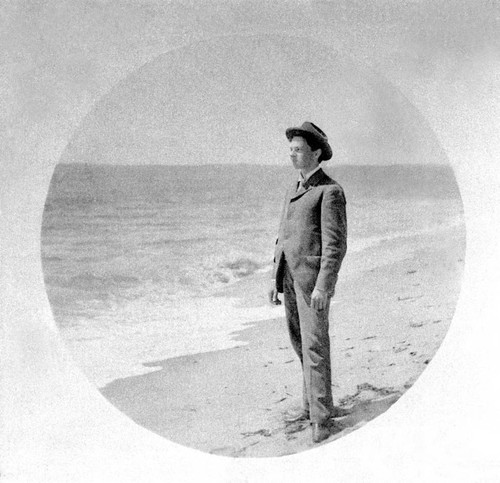 Portrait of Robert Bacon standing on a beach