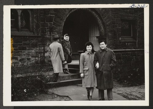 On their way to a picture show are Jimmie Okura and Jean Ikeguchi shown leaving the Co-op House in Cleveland