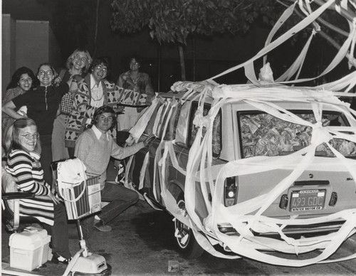 Students pose with TP'd car, circa 1976
