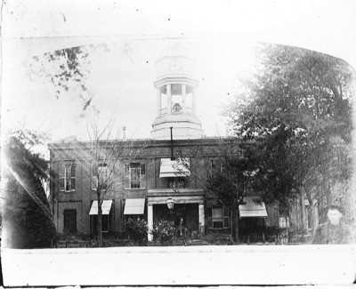 Courthouses - Stockton: Unidentified man in far right bottom corner standing in front of San Joaquin Co. Courthouse, Main St. and San Joaquin St