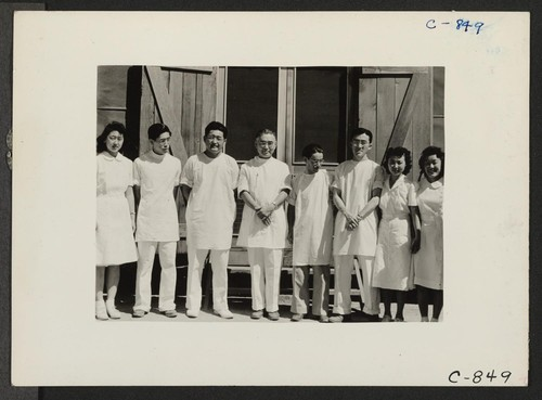 Manzanar, Calif.--Part of the dental clinic staff at this War Relocation Authority center for evacuees of Japanese ancestry. The entire staff is of Japanese descent. Photographer: Lange, Dorothea Manzanar, California