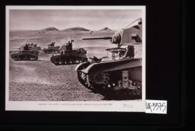 American-built tanks, manned by a famous Irish cavalry regiment, preparing for action in the Libyan desert