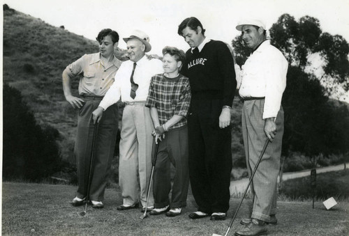 Golfers, including Mickey Rooney and Johnny Weissmuller, at the Bobby Jones Invitational Tournament, Avalon, California