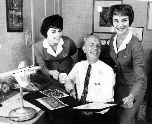 "Coffee, tea or milk? Kathy LaBelle offers a cup to ""Father of Stewardesses"""