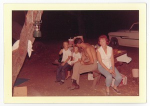 Lee Glaze, his sister, and parents at a campground