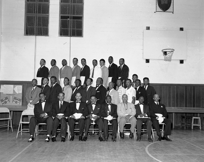 Group photograph of masons in basketball gym