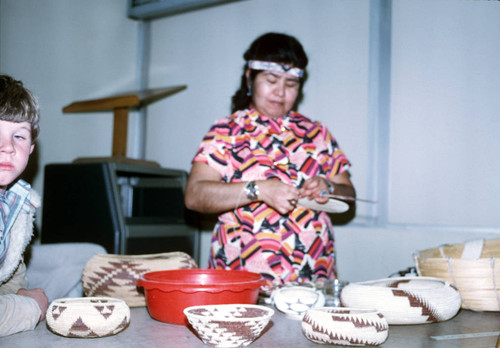 Bertha Wright-Jimenez making a basket