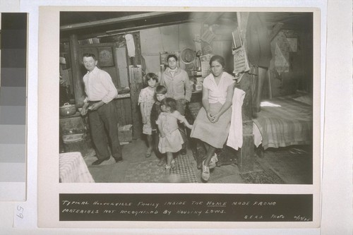 Typical Hooverville family inside the home made frome [sic] materials not recognised [sic] by housing laws. S.E.R.A. Photo, 4/17/35