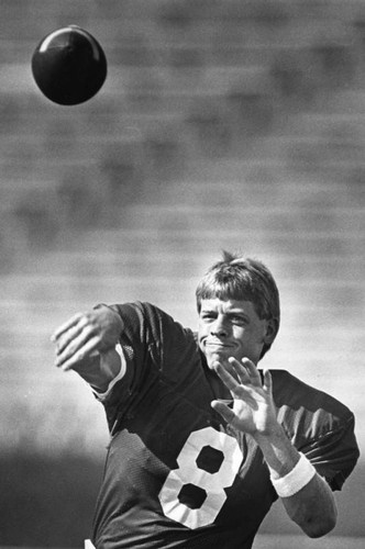 Aikman warms up his arm