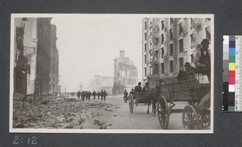 Looking towards the Ferry from Market near Kearny. Ruins of the Grand and Palace Hotels at the right and the air is yet dim with the smoke of the burning building. April 20, 1906