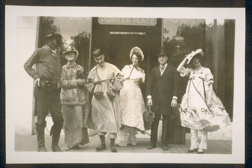 [Dressler and others in costume in front of Pioneer Place]