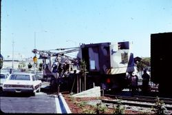 Workers putting the Pacific Fruit Express boxcar in place behind the West County Museum, August, 1982