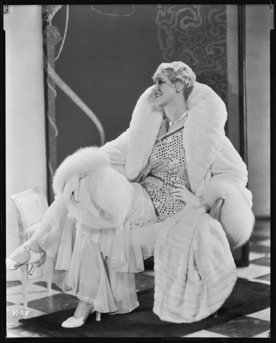 Peggy Hamilton modeling an ermine coat and chiffon evening gown, 1931
