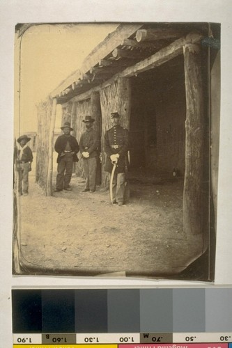 Capt [Captain] Atchison, his orderly and clerk in the rear of his dwelling, Ft. [Fort] Mojave