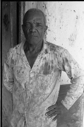 Man stands in front of a building, San Basilio de Palenque, 1975
